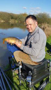 Andrew fishing with Burt Baits